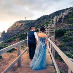 newly engaged couple in blue colour theme outfit walking on a bridge at Mornington Peninsula for their pre wedding photography package