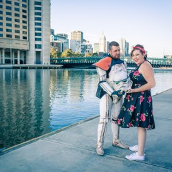sand trooper and wife giggling at Yarra River at Southbank Melbourne