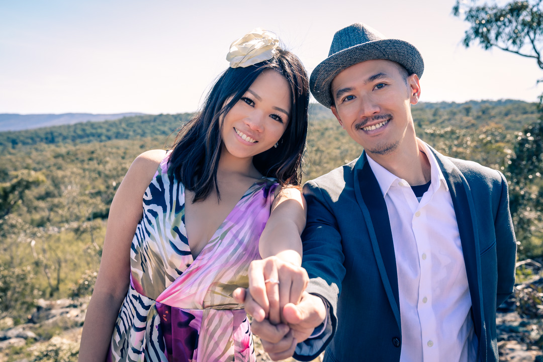 newly engaged couple showing off her engagement ring right after a surprise proposal at The Grampians national park in Australia