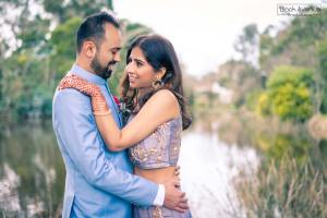 wedding photographers in Melbourne capture this amazing wedding photo showing couple look at each other in bridal gown by the lake and wood in Baxter Barn