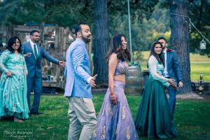 Melbourne bride groom and bridal party perform bollywood dance move at their Baxter Barn wedding event reception 2017