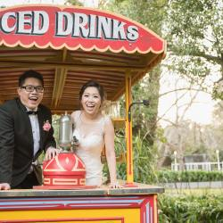 Easy weddings blog photo featured bride and groom on a vintage iced drink cart at Bram Leigh Receptions Melbourne laughing happily