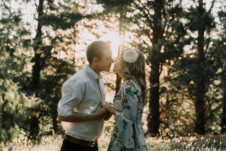 romantic engagement photo shoot session under sunset with couple face to face so in love in artistic mood