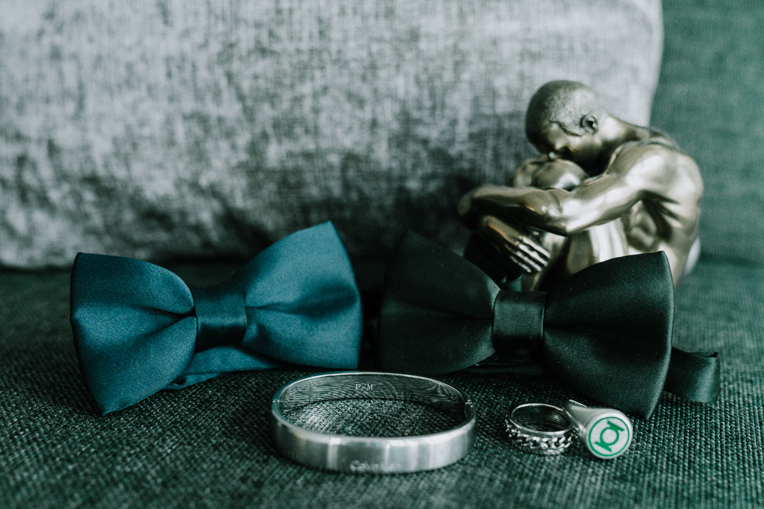 Gay wedding photo showing detail of bow ties and wedding rings
