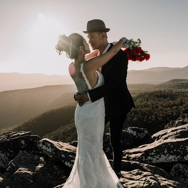 wedding photography Melbourne showing bride groom standing at hilltop Grampian National park Victoria
