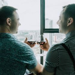 same sex engagement party groom prep photo as seen on Polka Dot Bride blog 2018
