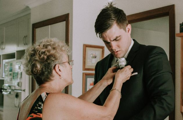 mom and son getting ready for his wedding day