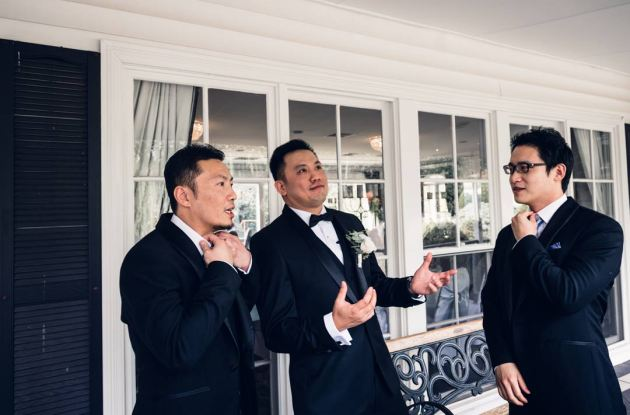 relaxed groomsmen chill out with groom before wedding ceremony at Ballara Reception