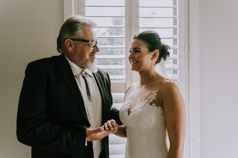 father of bride happily blessed his daughter before wedding ceremony