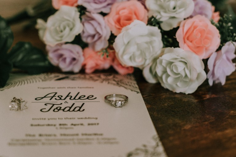 wedding invitation card and flower and engagement ring photo