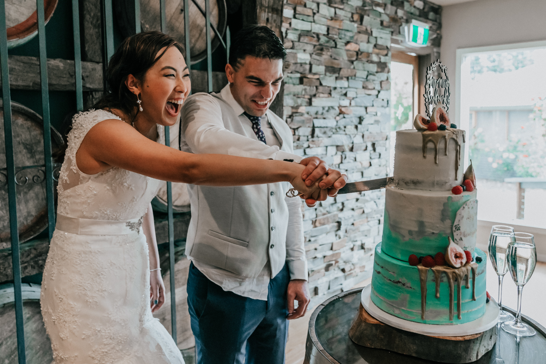Melbourne bride groom cutting wedding cake by Slice Cakes