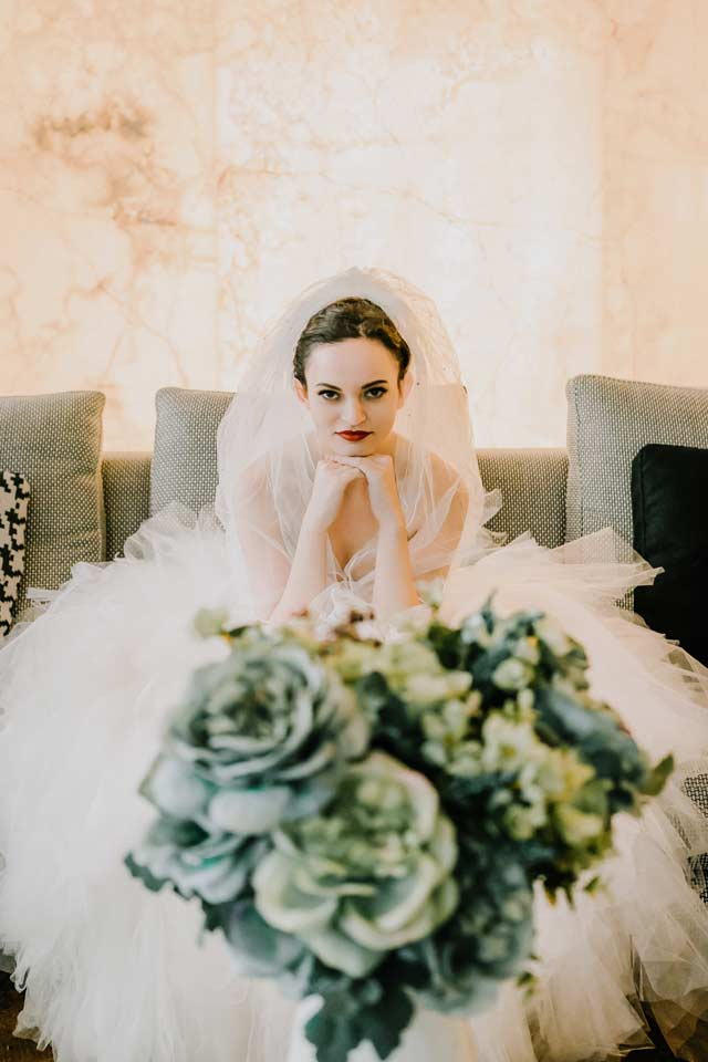 cool rock and roll bride sitting in her Docklands Melbourne wedding reception