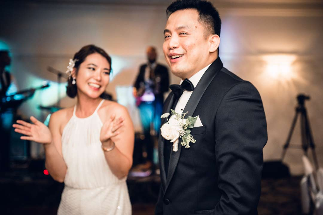 happy bride and groom first dance at reception