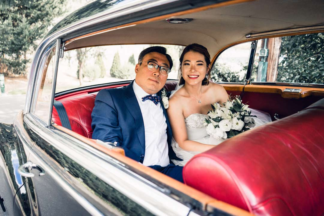 father and bride waiting inside classic vintage old wedding car from Triple R