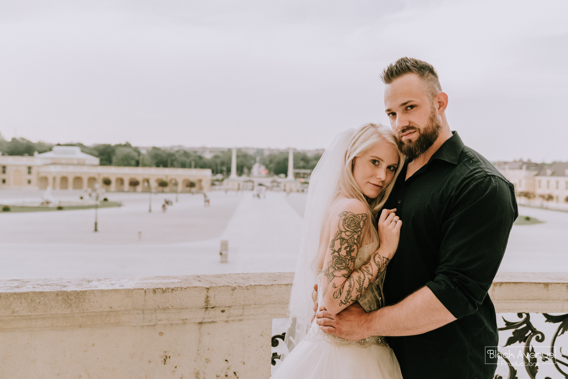 beautiful fitness bride and groom hug for their wedding photo in Belvedere Palace Vienna by destination wedding photographers from Black Avenue Productions