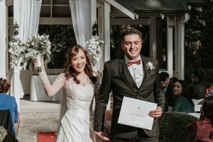 real candid moment of just married couple walking down the ceremony venue in Marybrooke Manor wedding captured by Black Avenue Productions