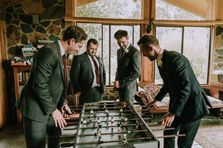 groom and groomsmen tribe having fun with soccer game before wedding ceremony captured by photographed by award winning photographer Derek Chan from Black Avenue Productions
