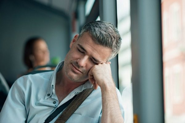 Man sleeping on a bus
