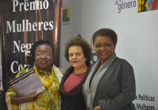 Winner Creuza Maria de Oliveira (left) poses with the ministers
