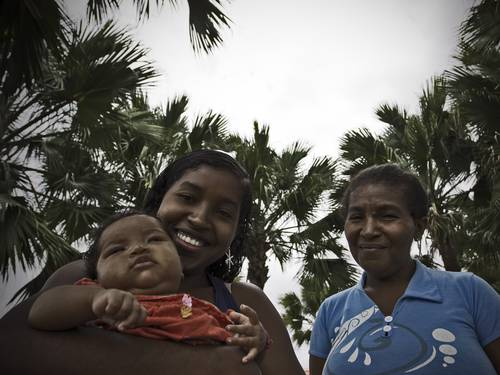 Maria Dalva Ferreira (right), 53, has 10 children and says that without the program her life would be much more difficult. Her daughter Maria Francisca, 17, is the mother of two children and also has also enrolled in the program