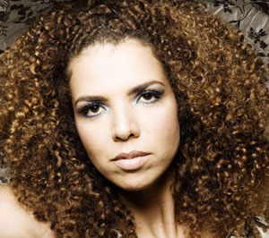 "Popular singer Vanessa da Mata. describes herself as a ""very mestiça (mixed) person. Some say I am negra black) of my hair and others say that I am white."""
