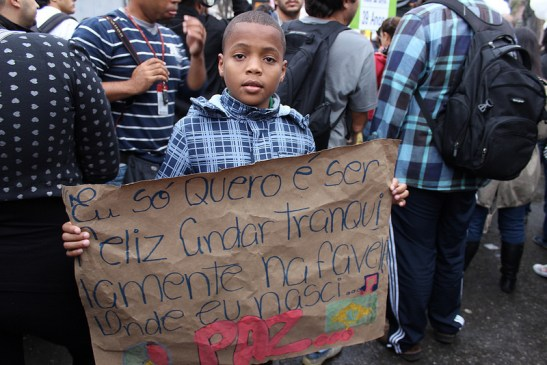 """Sign: """"All I want is to be happy to walk peacefully in the favela where I was born...PEACE."""""""