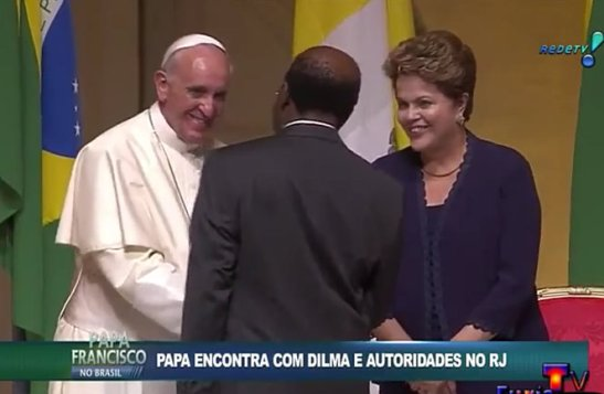 Supreme Court president Joaquim Barbosa greets the Pope during a ceremony in Rio de Janeiro