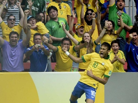 Star player Neymar celebrates in front of a crowd at a recent match