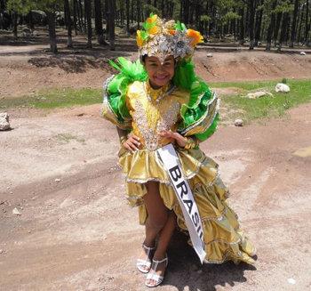 Little Mini Miss America International in her evening dress inspired by Carmen Miranda