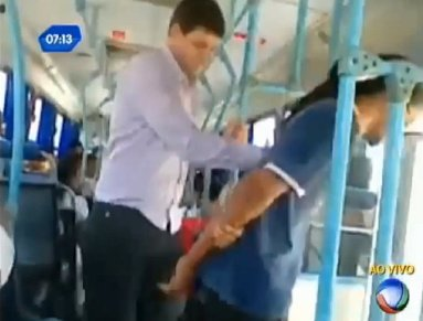 Barbosa, right, being forcibly removed from the bus