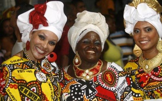 Women dressed in the attire of the Ilê Aiyê bloco afro