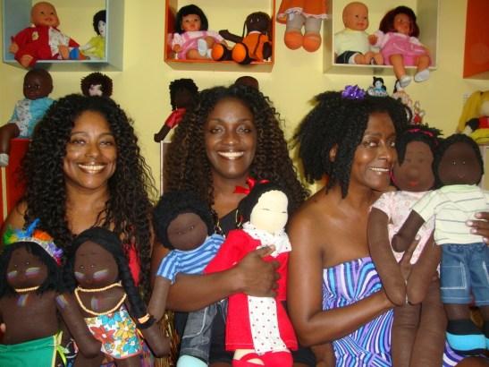 Cristina, Joyce and Lúcia of Preta Pretinha show off some of their work