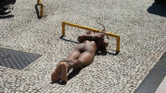 On January 9th in the Botafogo neighborhood of Rio, a naked black male was found tied to a pole on the ground in the scorching heat