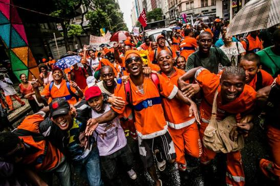 After more than a week on strike, sanitation workers celebrate victory