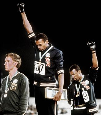 Tommie Smith and John Carlos, fist in the air, at 1968 Olympics
