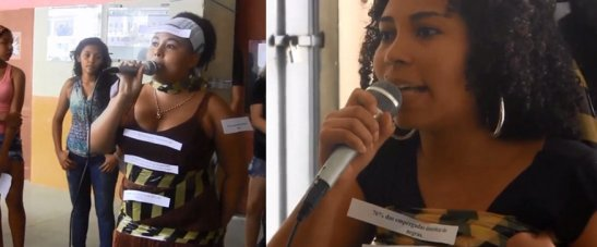 """Members of Preta Simoa address the crowd. At right on a small sign reads: """"76% of maids are black women"""""""