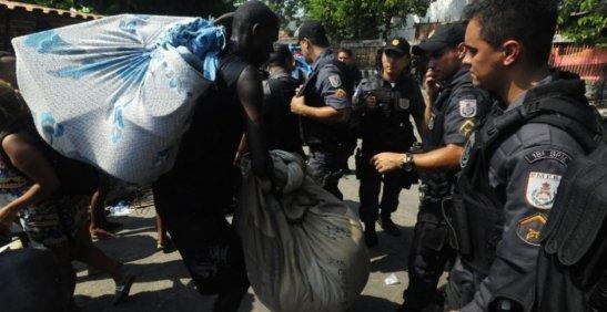 Man leaving the premises with his belongings