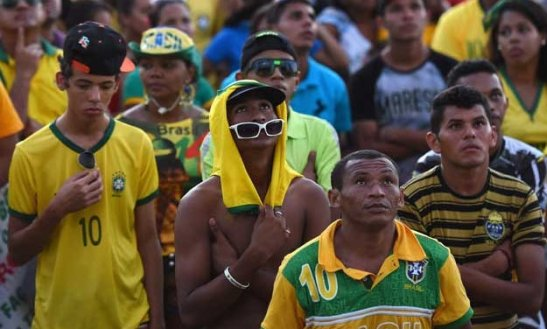 Fans watching World Cup match on large television