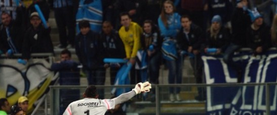Santos goalie Aranha gestures to the crowd after he heard racist insults