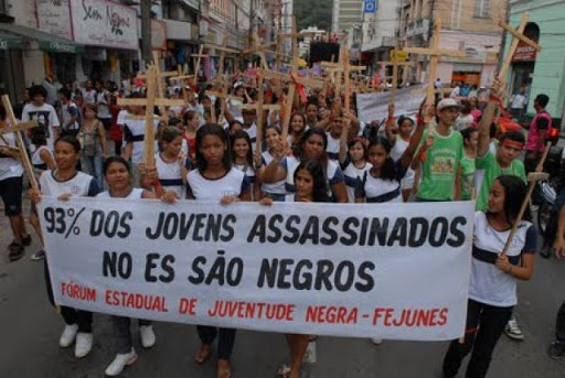 "Sign: ""93% of youth killed in (state of ) Espírito Santo are black"""