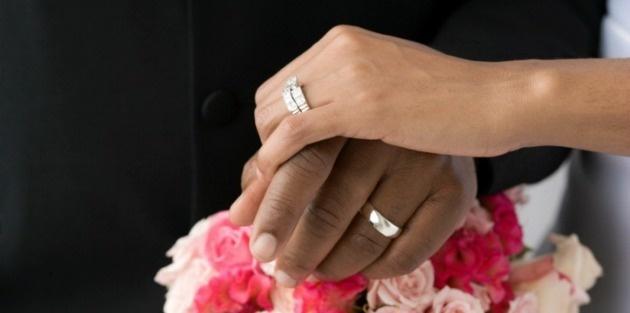 wedding_interracial_hands_edited.630w.tn