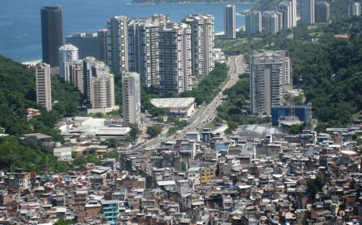 Maps reveal racial segregation in Brazil. Photo showing the poor hills and rich asphalt of Rio