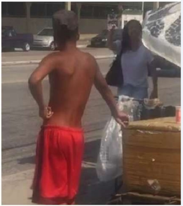 Woman Threatens Black Street Vendor, calls him 'monkey'