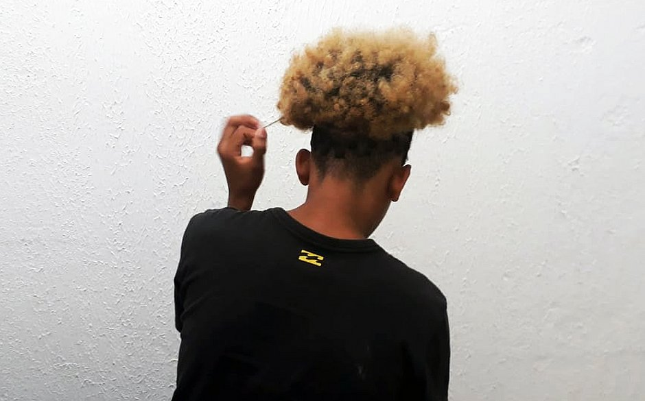 Military Police Caught Black youth because he Wore an Afro