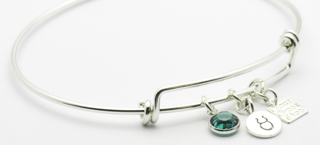 May Emerald Taurus Charm Bracelet