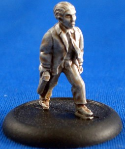 Investigator walking with pistol