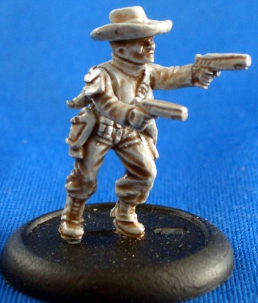 Female trooper in cowboy hat with twin pistols