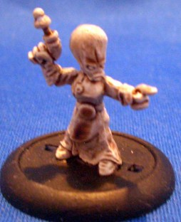 Grey alien female with pistol