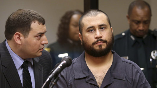 George Zimmerman (R), the acquitted shooter in the death of Trayvon Martin, listens to defense counsel Daniel Megaro during his first-appearance hearing in Sanford, Florida November 19,  2013. A central Florida judge freed Zimmerman on $9,000 bond on Tuesday and forbade him from possessing weapons or ammunition on charges of aggravated assault with a deadly weapon and domestic violence during a dispute with his girlfriend.  REUTERS/Joe Burbank/Orlando Sentinel/Pool   (UNITED STATES - Tags: CRIME LAW)