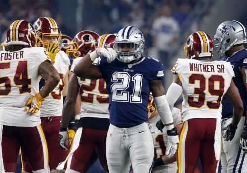 """Dallas Cowboys running back Ezekiel Elliott (21) mimes""""eating"""" after running the ball for a first down as Washington Redskins inside linebacker Mason Foster (54) safety Donte Whitner (39) stand at rear during the second half of an NFL football game, Thursday, Nov. 24, 2016, in Arlington, Texas. (AP Photo/Ron Jenkins)"""